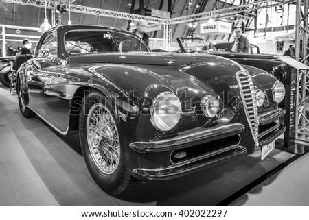 "STUTTGART, GERMANY - MARCH 17, 2016: Vintage car Alfa Romeo 6C 2500 SS Touring Superleggera Coupe, 1948. Black and white. Europe's greatest classic car exhibition ""RETRO CLASSICS"" - stock photo"