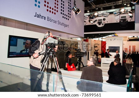 "STUTTGART - MARCH 18: Booth of Boerse (Stock Exchange) Stuttgart with TV studio to record financial news at ""Invest"" exhibition at the Trade Fair on March 18, 2011 in Stuttgart , Germany. - stock photo"