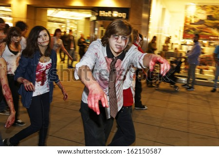 STUTTGART - OCTOBER 26: The Annual Zombie Walk Stuttgart People dress as Zombies and scare people in Stuttgart City. October 26, 2013 in Stuttgart, Germany. - stock photo