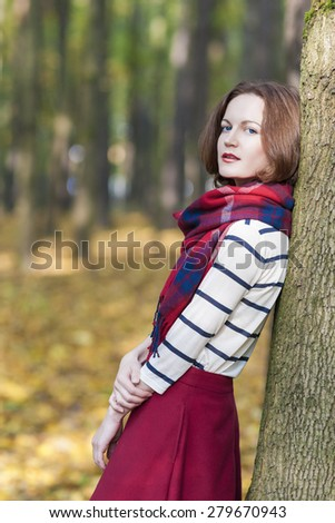 Style Concept: Young Caucasian Brunette Female in Made to Measure Clothing. Outdoors Photoshot. Vertical image - stock photo