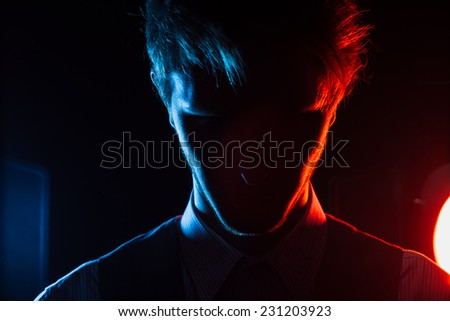 Style man silhouette portrait with red and blue filters - stock photo