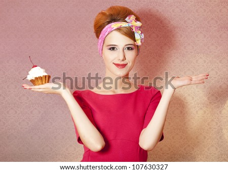 Style redhead girl with cake at pink background. - stock photo