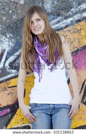 Style teen girl near graffiti wall. - stock photo