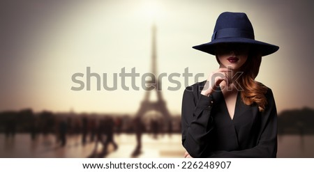 Style women in hat and parisian background - stock photo