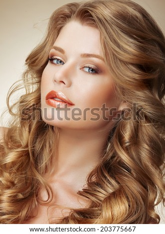 Styling. Gorgeous Fashion Model with Perfect Light Silky Hair - stock photo