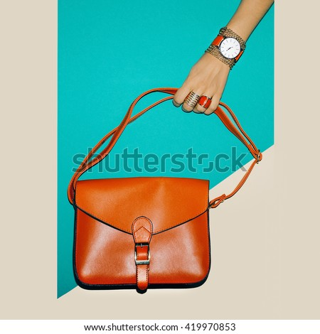 Stylish Accessories. Focus on Red. Bag Ladies and Jewelry. - stock photo