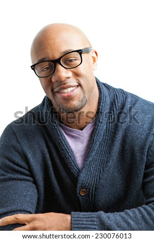 Stylish African American man wearing black framed glasses. Shallow depth of field. - stock photo