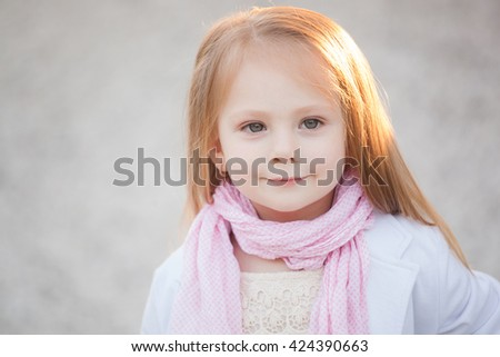 Stylish baby girl with blonde hair outdoors. Little girl 2-3 year old - stock photo