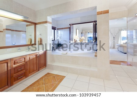 Stylish bathroom in luxury house - stock photo