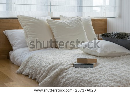 stylish bedroom interior design with black and white pillows on bed. - stock photo