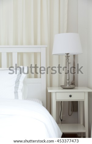 stylish bedroom interior design with table lamp - stock photo