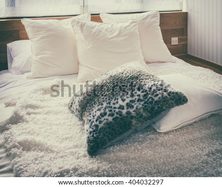 stylish bedroom interior with black and white pillows on bed- vintage style effect - stock photo