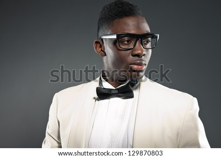Stylish black american man in suit with glasses. Fashion studio shot. - stock photo