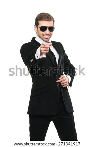 Stylish bodyguard pointing his forefinger at viewer. Isolated on a white background - stock photo