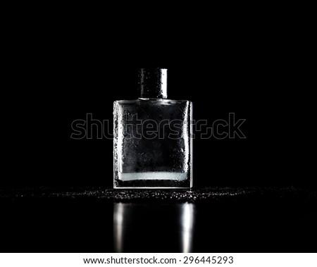 stylish bottle of perfume on black - stock photo