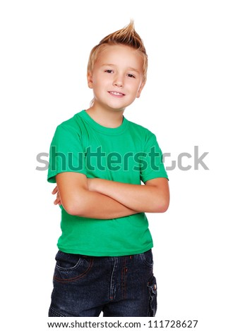 Stylish boy in green top on white background - stock photo
