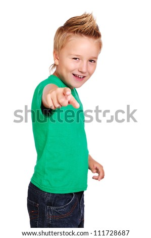 Stylish boy in green top on white background pointing with his finger - stock photo
