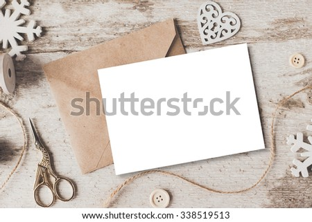 Stylish branding mockup to display your artworks. Cute vintage christmas new year gifts mock up on wooden background. - stock photo