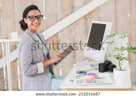 Stylish brunette working from home in her home office - stock photo