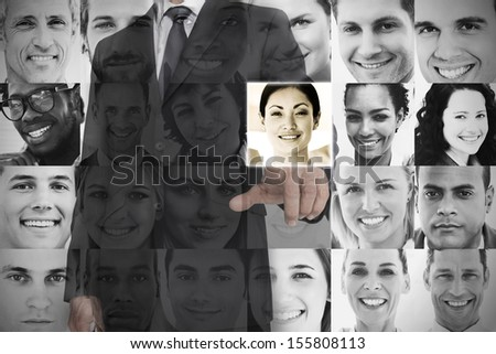 Stylish businessman choosing profile picture on digital screen - stock photo