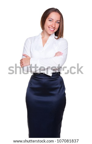 stylish businesswoman with crossed hands posing over white background. studio shot - stock photo