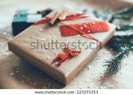 Stylish Christmas gifts box presents on brown paper - stock photo