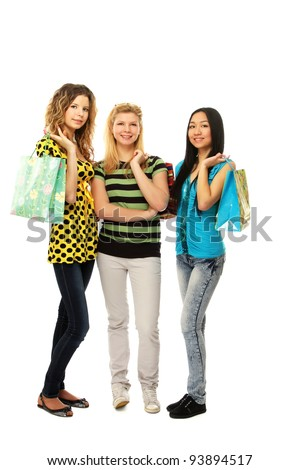 Stylish college girls with shopping bags , isolated on white background - stock photo