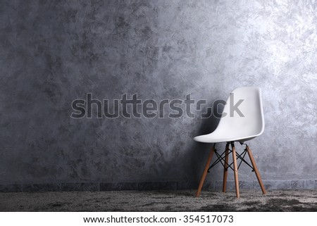 Stylish conception with one white chair on grey background - stock photo