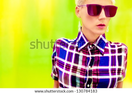 Stylish country girl on a bright yellow background - stock photo