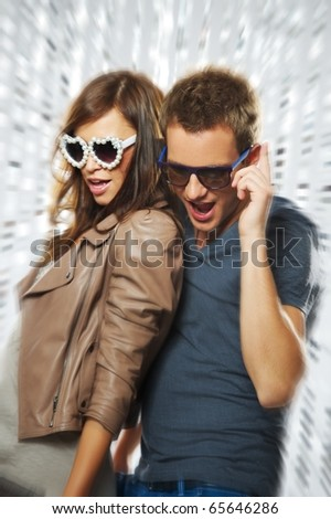 Stylish couple dancing in the nightclub - stock photo