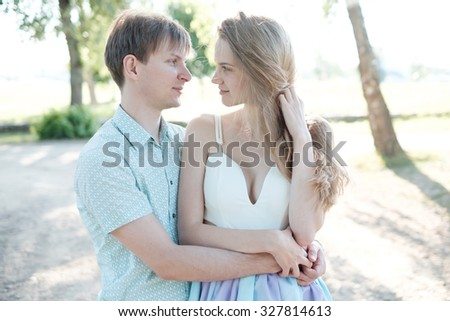 stylish couple in love together in the park - stock photo