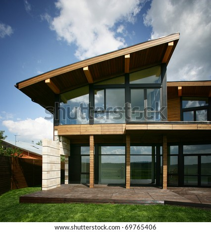 Stylish design house with the big glass windows - stock photo