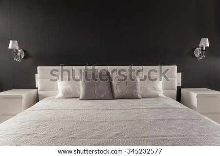 Stylish elegant bed in contemporary master bedroom - stock photo