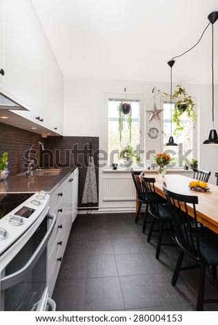 stylish fancy kitchen interior black floor - stock photo