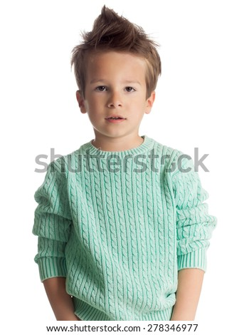 Stylish five year old European boy posing isolated over white studio background in knitted pullover. Fashion child. Confident little boy.  - stock photo