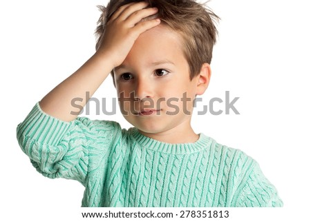 Stylish five year old European boy posing over white studio background. Stunned surprised expression on child face. Face palm gesture. - stock photo