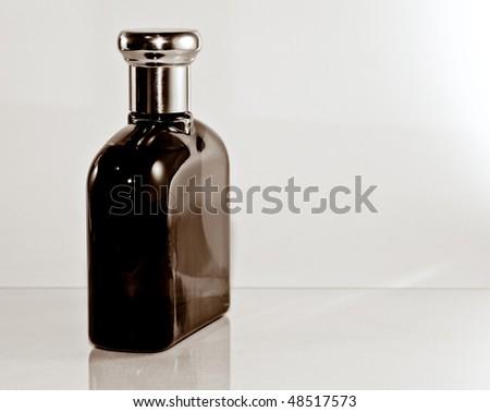 Stylish glass parfume bottle isolated - stock photo