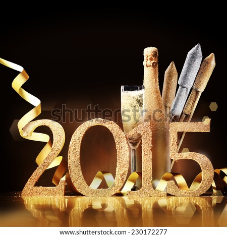 Stylish gold themed 2015 New Year background with the date in numbers, an elegant flute and bottle of champagne, fireworks and a coiled golden ribbon over brown with copyspace for your greeting - stock photo