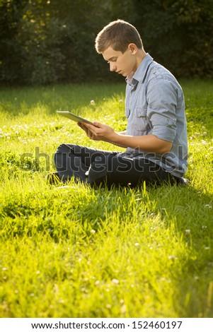 Stylish guy using electronic tablet - stock photo