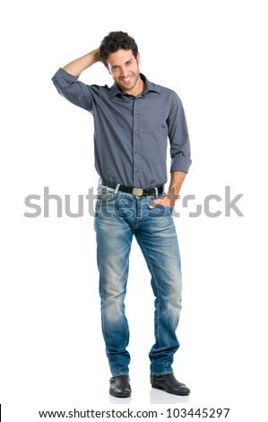 Stylish happy young man looking at camera with embarrassment isolated on white background - stock photo