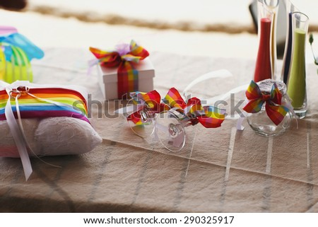 stylish hawaiian colorful decorated glasses and pillow and sand on cyprus - stock photo