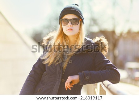 Stylish hipster girl posing in the city a warm day, fashion photo - stock photo