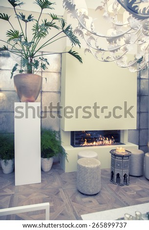 Stylish interior in retro style. Image toned, noise added and vignetted - stock photo