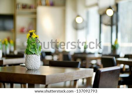 Stylish interior of a cozy restaurant - stock photo