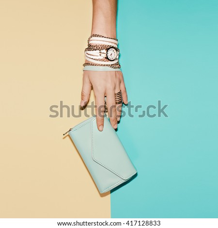 Stylish Ladies Accesories. Clutch and Jewelry. Vanilla Summer. - stock photo