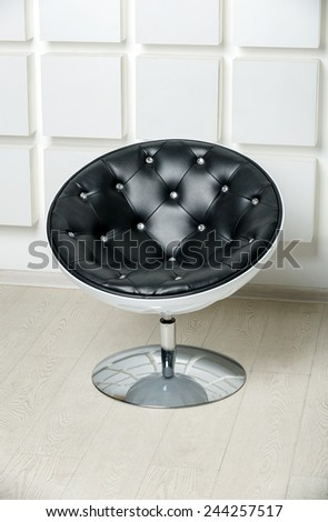 stylish leather chair with crystals in simple interior - stock photo