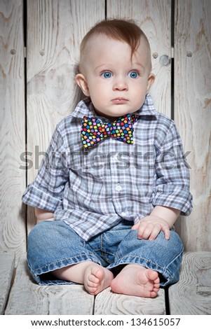 stylish little boy in bow tie - stock photo