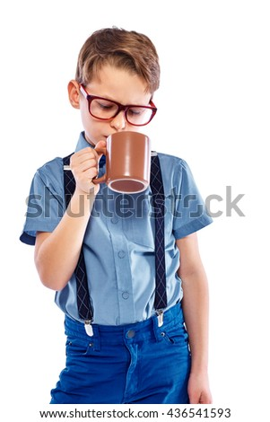 Stylish little boy in glasses is drinking of tea, coffee or juice. Isolated on a white background. - stock photo