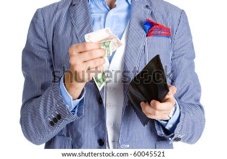 Stylish man holding a few notes and a purse - stock photo