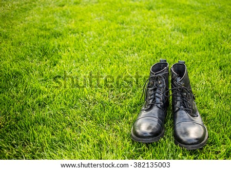Stylish man shoes on green grass - stock photo